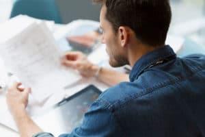 man reading a cbd lab report