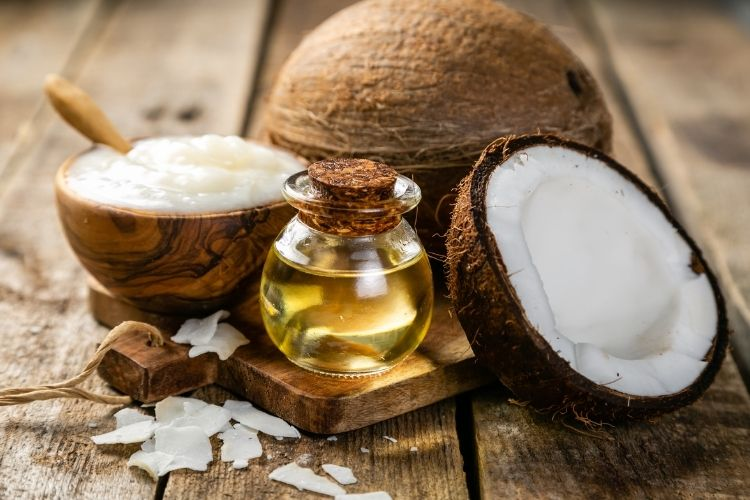 mct oil and different products from coconuts in a wood background